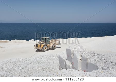 Bulldozer At Marble Quarry On Island