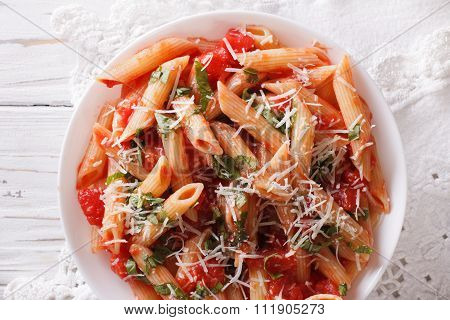 Arrabiata Pasta Penne With Parmesan Cheese Closeup. Horizontal Top View