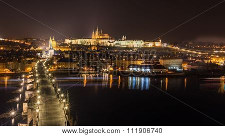 Aerial Sunset View On Charles Bridge And Prague Castle
