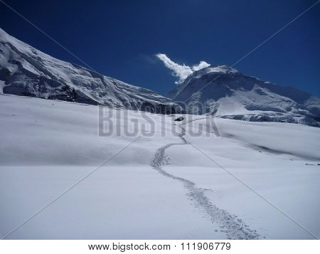 A Footpath At The Snow-covered Mountain Pass In Himalaya