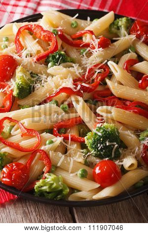 Pasta Penne Primavera With Vegetables Close-up. Vertical