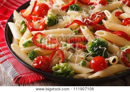 Pasta Penne Primavera With Vegetables Close-up. Horizontal