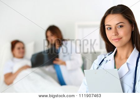 Beautiful Female Medicine Doctor Looking In Camera