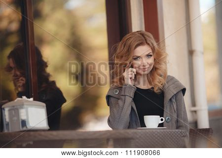 Morning coffee at a table in a café for beautiful women .
