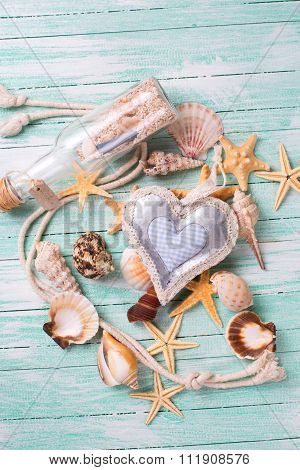 Marine Items And Decorative Heart On Turquiose Wooden Background.