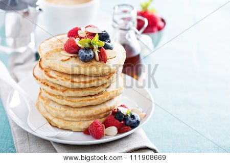 Fluffy oatmeal pancakes stack with fresh berries