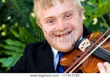 Face Shot Of Handicapped Violinist Outdoors.