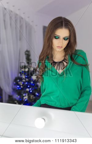 Fashionable beautiful sexy elegant woman with bright evening make-up in shades green with long hair