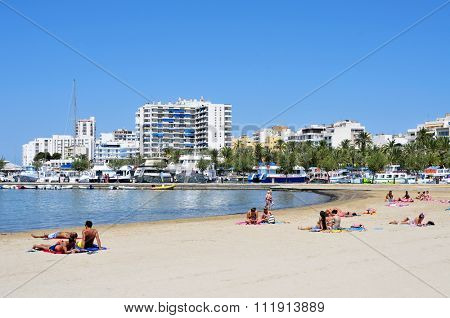 SAN ANTONIO, SPAIN - JUNE 19: Sunbathers at Arenal Beach on June 19, 2015, in San Antonio, Ibiza Island, Spain. Ibiza is a well-known summer tourist destination in Europe