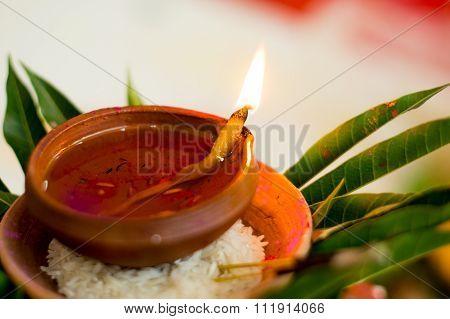 Earthenware lamp in hindu ritual