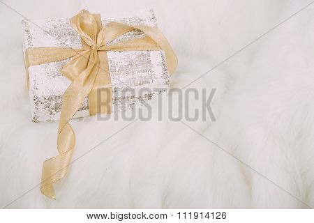 Shabby Chic Gift With Golden Ribbon On White  Background