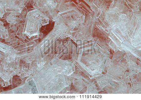 Macro photo of ice crystals on orange background