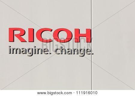 Ricoh logo on a wall