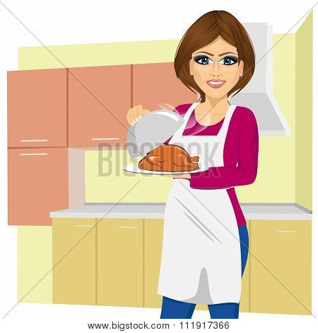woman cooking traditional thanksgiving turkey