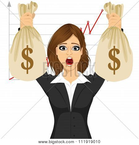 businesswoman holding two big dollar money bags