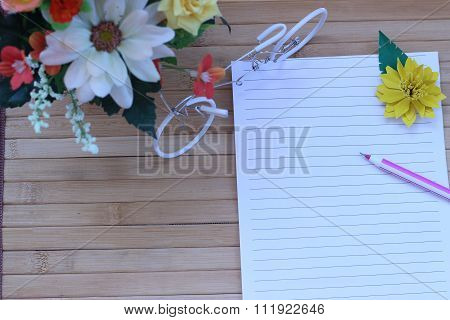 Writing Paper And Pen Placed On A Wooden Brown Background