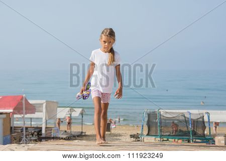 Six Year Old Girl Walking On Wooden Flooring From The Sea Home