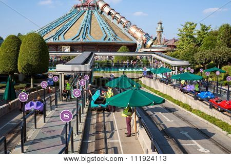 FRANCE, PARIS - 10 SEP, 2014: Attraction Autopia and Space Mountain Mission 2 with futuristic design in Disneyland.