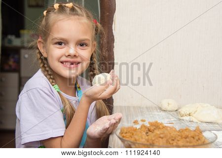 Cheerful Girl Stained With Flour Made Patty With Cabbage