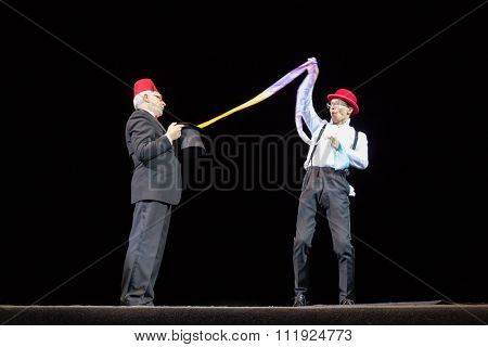RUSSIA, MOSCOW - 18 DEC, 2014: Performer is showing hocus-pocus and take out scarf from the cylinder at Aquamarine circus.