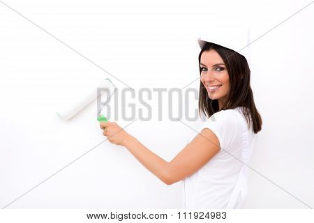 Beautiful Young Woman Painting A Apartment.
