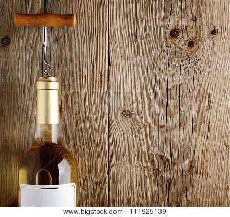 Wine Bottle On Old Wooden Background