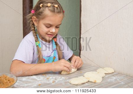 Cheerful Six Year Old Girl Sculpts Cakes With Cabbage