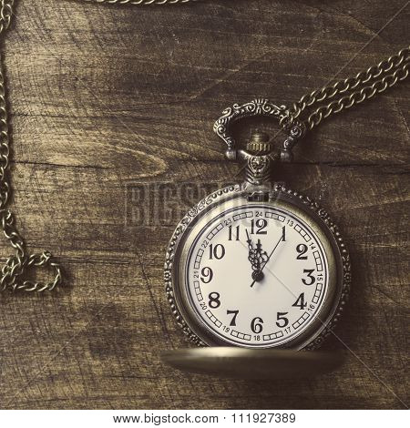 Photo  Of Old Vintage Pocket Watch On Rustic Wood