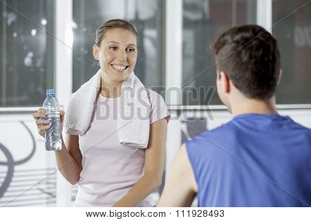 Young Couple Socializing At The Gym