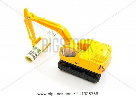 Dollars Banknotes And Backhoe On White