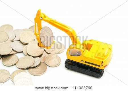 Russian Coins And Backhoe On White