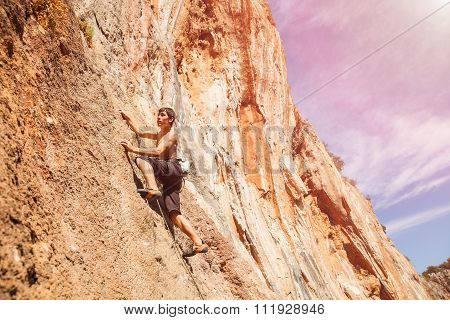 Male rock climber on the wall