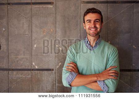 Portrait Of Male Designer Standing In Modern Office