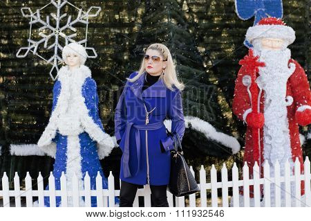 The Beautiful Woman Between The Snow Maiden And Ded Moroz Against A New Year Tree