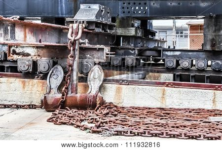 Dunnage and Rusted Chain: Dry-Dock Support