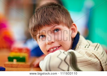 Portrait Of Young Smiling Boy, Kid With Disabilities