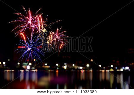 Fireworks Celebration And The City Night Light Background.