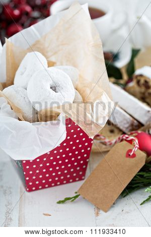 Food gifts donuts and christmas stollen with tea