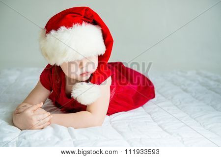 Little Girl in Hat Santa