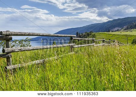 Old Wooden Farm Fence At Scenic Lake Shore