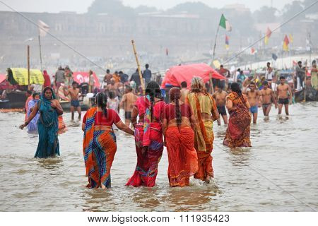 ALLAHABAD, INDIA - FEBRUARY 07, 2013: Thousands of Hindu devotees come to confluence of the Ganges and Yamuna River for holy dip during the festival Kumbh Mela. The world's largest religious gathering