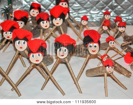 Caga Tio (tio De Nadal) For Sale On Counter Of Christmas Market.