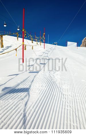 Close up shot of piste marking posts in Dolomites Italy