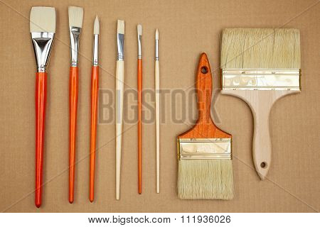 Paintbrushes On Cardboard