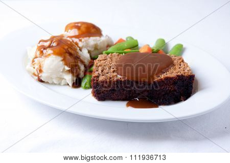 Meatloaf With Mashed Potatoes And Gravy