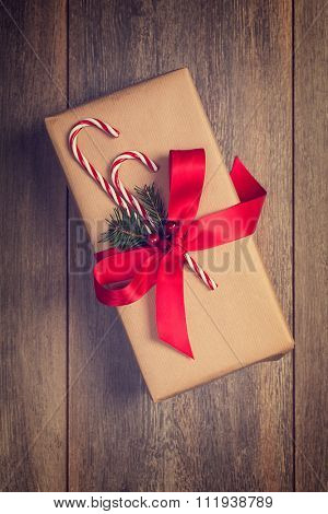 Christmas gift box with candy cane decoration