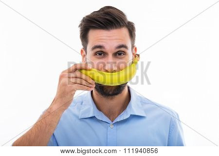 Man holding banana over face