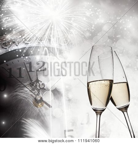 New Year's at midnight with champagne glasses and clock on light background