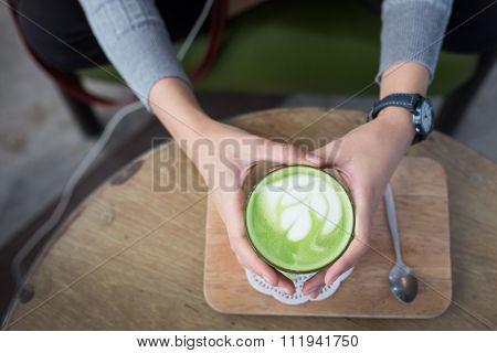 Cup Of Matcha Green Tea In Woman Hand.