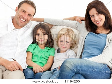 Portrait Of A Family On The Sofa